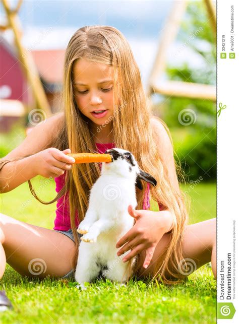 Happy Family Garden - happy child with bunny pet at home in garden royalty free stock images image 33421219