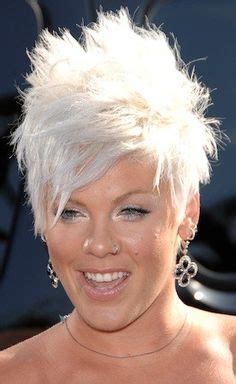 short coiffed hairstyles female executive platinum blonde white hair