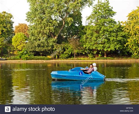pedal boat in hyde park couple in pedal boat on the serpentine river hyde park