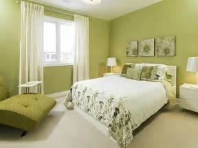 Add green plants to the bedroom to add a level of interest to the room