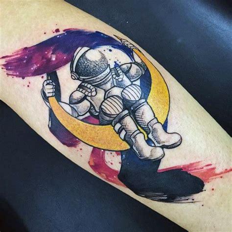 cartoon rocket tattoo old school style colored astronaut on moon arm tattoo
