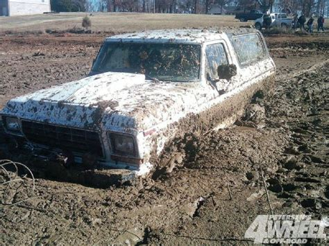white jeep stuck in mud 131 1204 27 whoops 1985 jeep cj 7 carriage