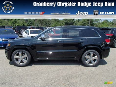 light brown jeep 2014 black forest green pearl jeep grand cherokee overland
