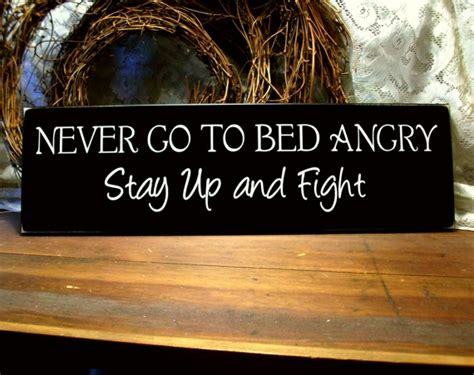 never go to bed angry never go to bed angry funny wood sign with saying wall
