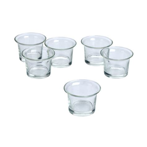 light in the clear glass lip votive candle holders
