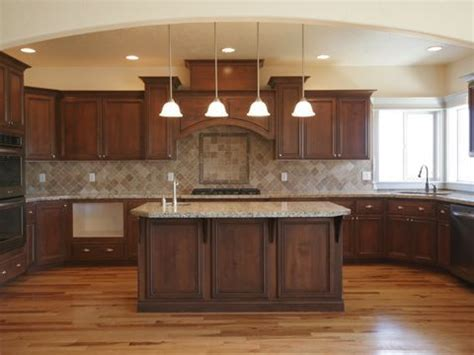 kitchen with brown cabinets wood floor dark cabinets lighter tan or brown counter
