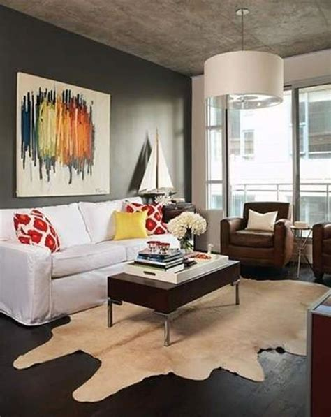 living room with cowhide rug decorating with cowhide rugs
