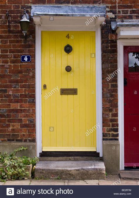 yellow front doors yellow front door in a row of terraced houses