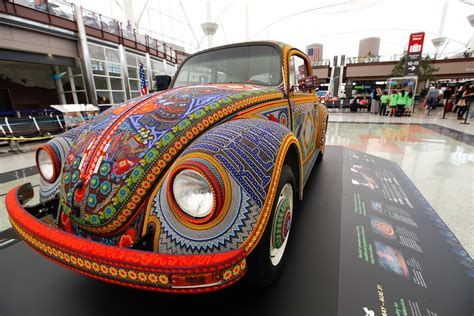 bead car beaded volkswagen rolls into denver airport stuck at the