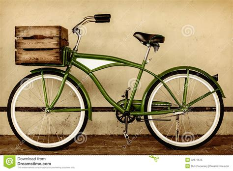 cruiser image retro styled sepia image of a vintage bicycle with wooden