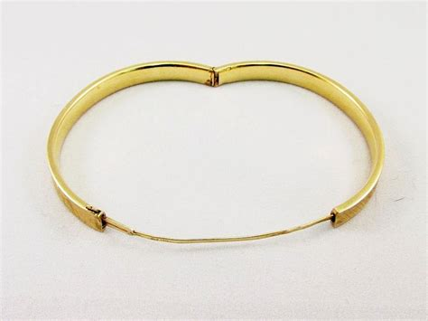 14 karat gold bangle bracelet from warejewelry on ruby