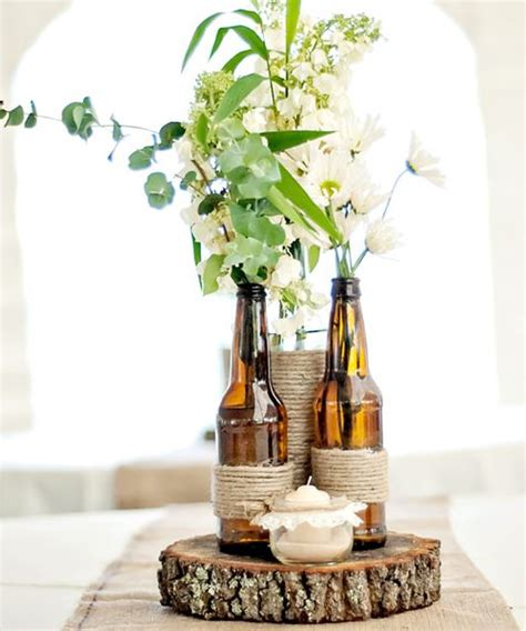 wine bottle vase centerpieces 10 wine bottle centerpieces for your wedding vinepair
