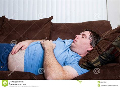bbw on couch fat man laying down stock photo image of laziness