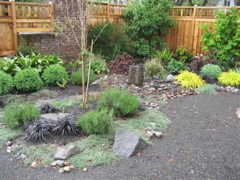 small backyard makeover small backyard makeover including bubbler rock and