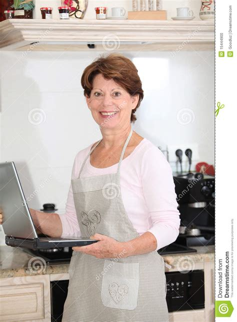 Standing In The Kitchen by Senior Standing In Kitchen Stock Photo Image 15444900