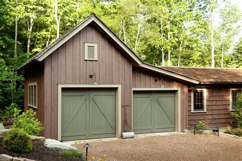 garage with board and batten siding shed