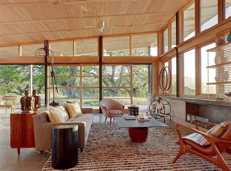 stylish mid century house with warm colored wood decor defining elements of the modern rustic home