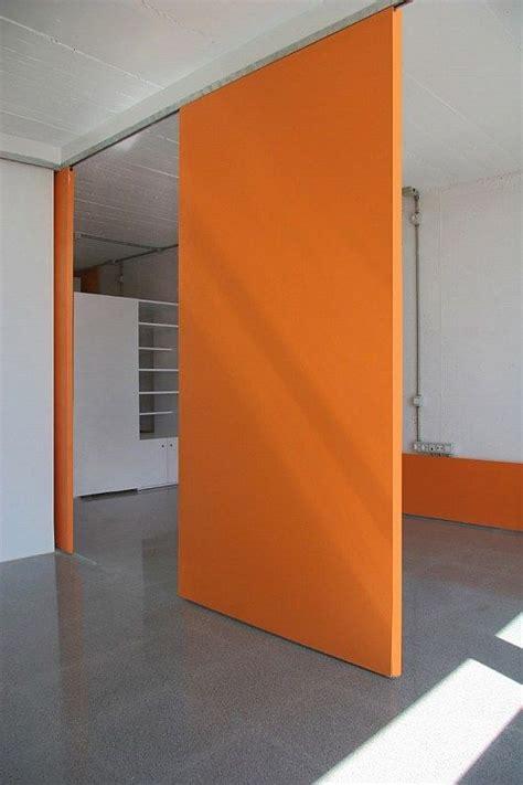 sliding wall panels orange wall concrete floor room divider ideas sliding doors orange walls and
