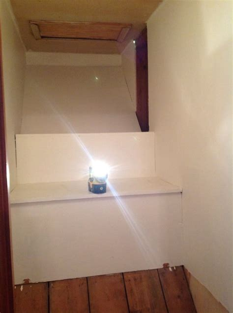 Odd shaped closet over basement stairs. Wondering how to