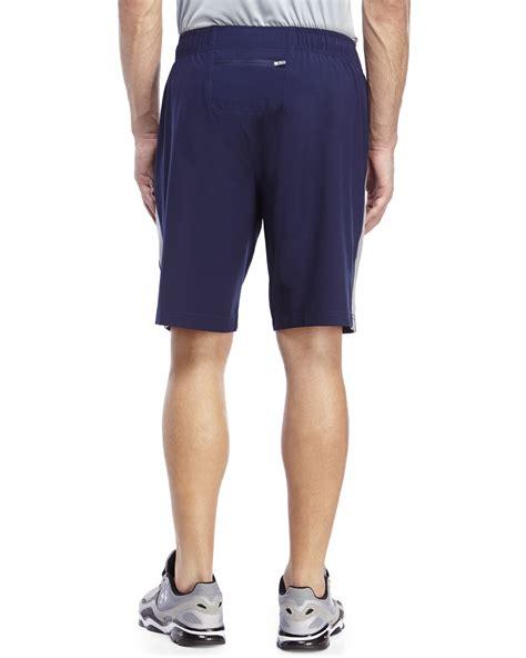 bold shorts light grey navy lyst reebok navy light grey rip curl slim fit shorts in blue for