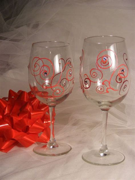 christmas patterned wine glasses hand painted christmas wine glasses with red swirls and