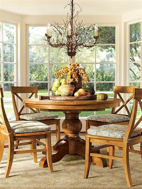 centerpiece dining room table a round dining table with a bountiful centerpiece