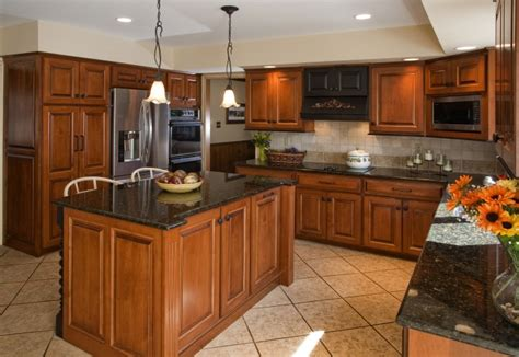 which wood is best for kitchen cabinets brown wooden kitchen cabinet with high storage on the