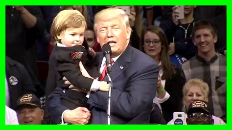donald trump holding little boy mini donald steals show at trump rally video the 405 media