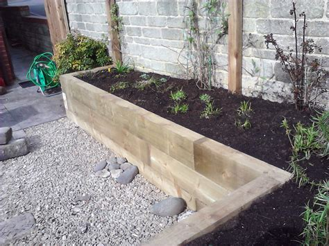 Building A Raised Bed With Sleepers by Railway Sleepers As Garden Features J B Lanscapes
