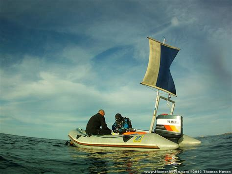 zodiac dive boat www thomashoven scuba diving and picking scallops at