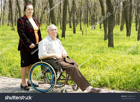 one leg wheelchair smiling elderly one leg utated stock photo