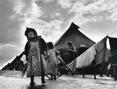 the spanish civil war 0304358401 robert capa refugee child crying refugee on bags spain spanish civil war