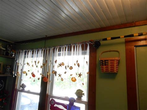 seashell curtain rods re purposed fishing poles as curtain rods with tulle