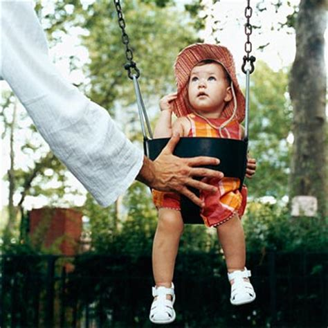 baby on a swing playground activities for babies what to expect