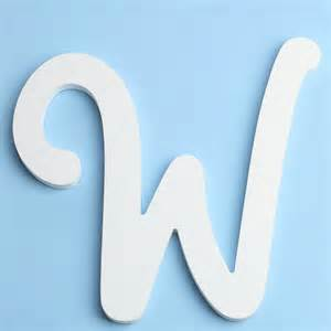 White brush font wood letter w word and letter cutouts