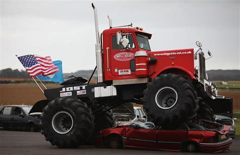 videos of monster trucks crushing cars car crushing monster truck launches the magnificient