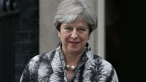 theresa may apologises to own mps for election mess