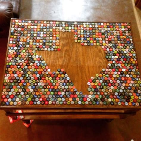 the 25 best ideas about bottle cap table on