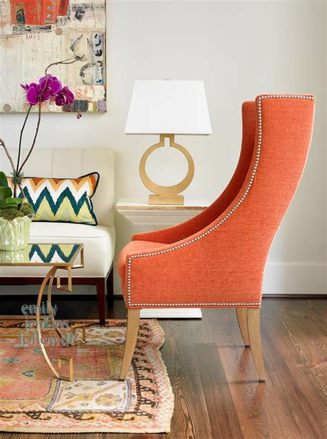 orange living room chair orange chair transitional living room olive interiors