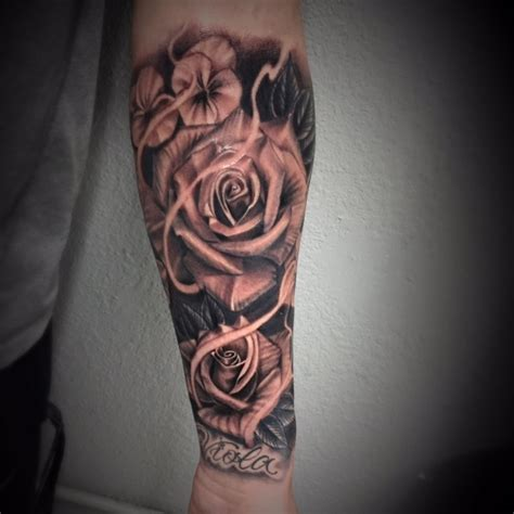 black and grey rose tattoo by salvador diaz at certified