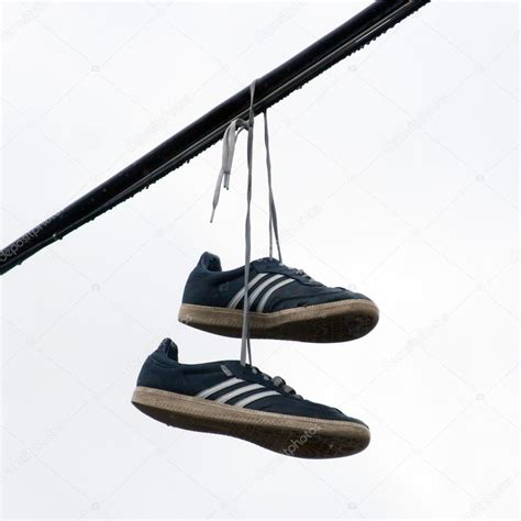 hanging photos on wire shoes hanging on a wire stock photo 169 premek 26635763