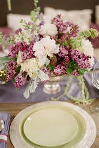 purple and white centerpieces with lilac flowers lilac