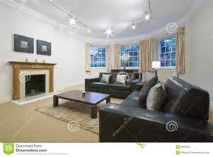 Wood Settee Living Room With Large Bay Window Stock Photography