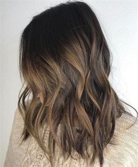 a line with subtle balyage highlights hair balyage picture of dark brunette hair with subtle bayalage