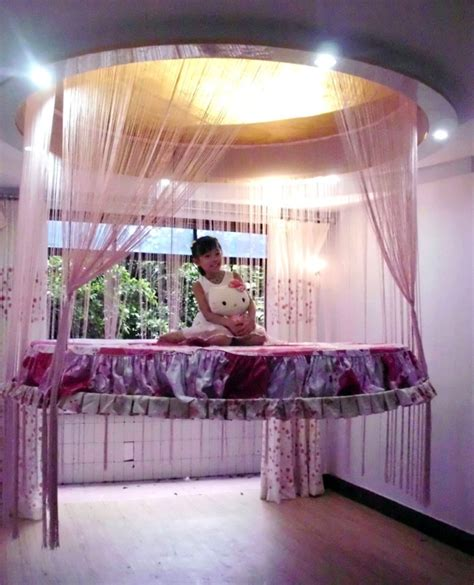 cool girl beds floating bed that retracts back into the ceiling to save