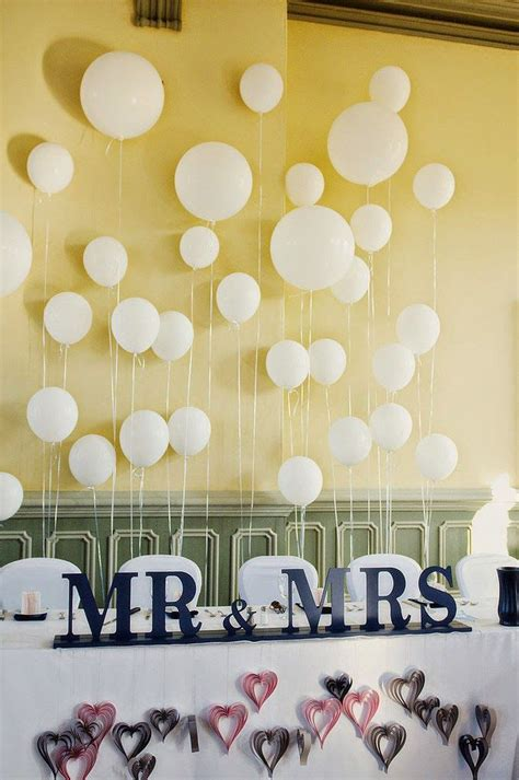 picture  white balloons attached   wall   fun