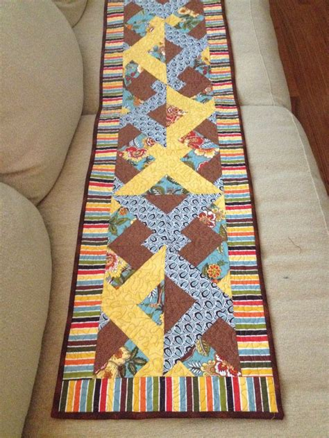 a well runners and quilt on