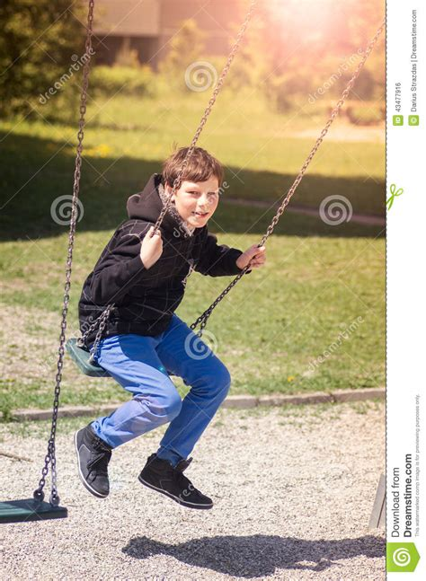 young swing boy in the playground stock photo image 43477916