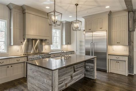 gray reclaimed wood kitchen island with farmhouse sink