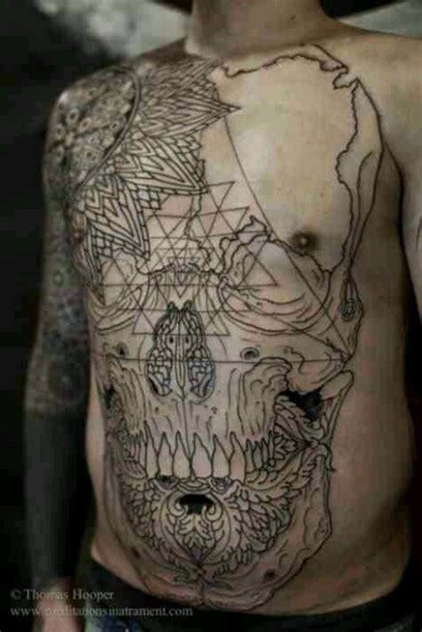 chest tattoo lines skull tattoo tattoo line work intricate design black
